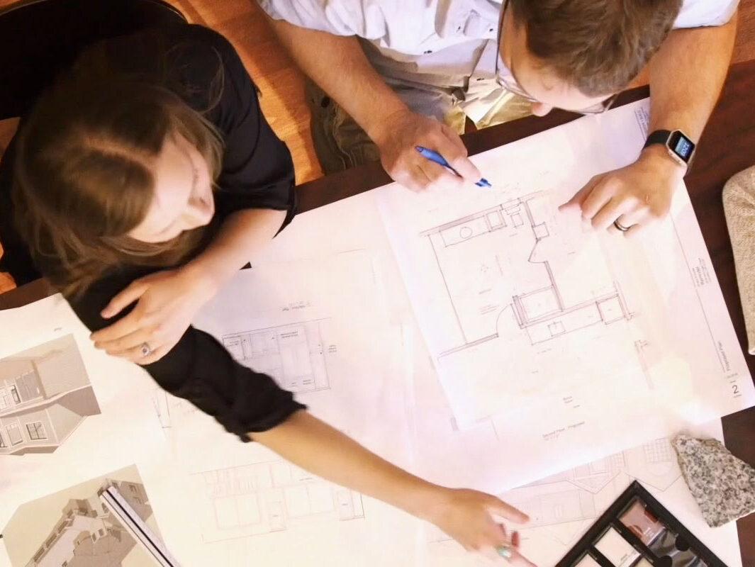design-build contractor and designer discuss plans