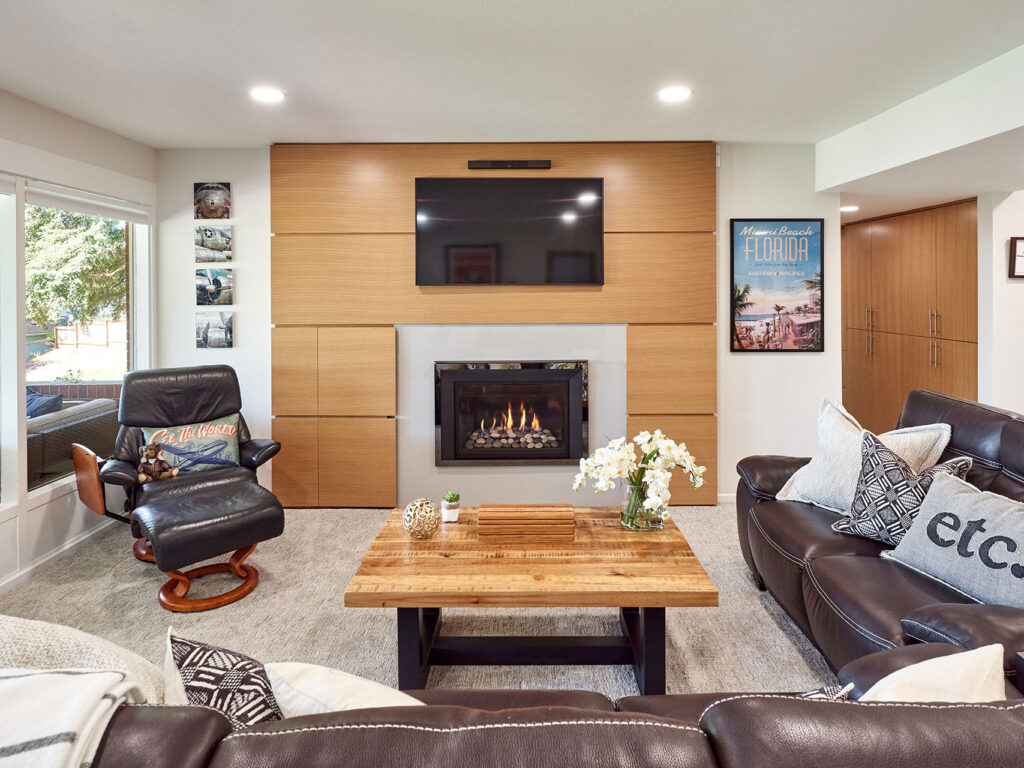 Basement remodel includes fireplace design. Custom home remodel from Henderer Design + Build + Remodel
