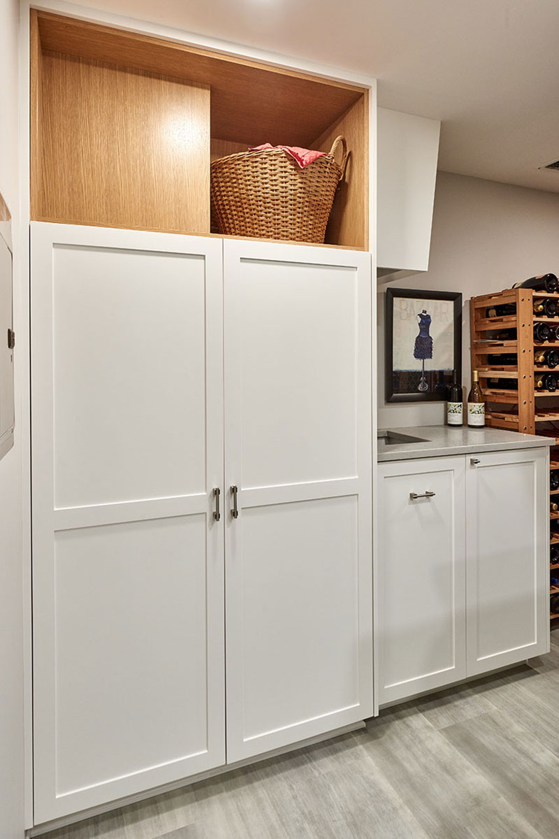 Basement remodel includes closet and cabinetry design. Custom home remodel from Henderer Design + Build + Remodel