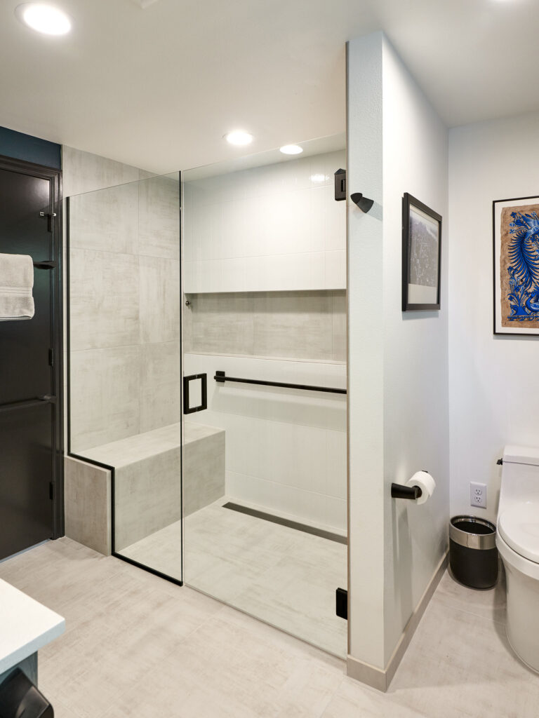 universal design and your forever home - aging in place curbless shower with built in bench - henderer design and build