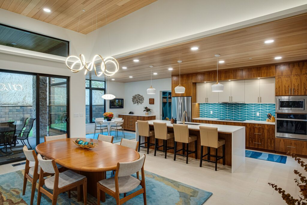 Open concept mid century modern dining room to kitchen with outdoor sight-lines