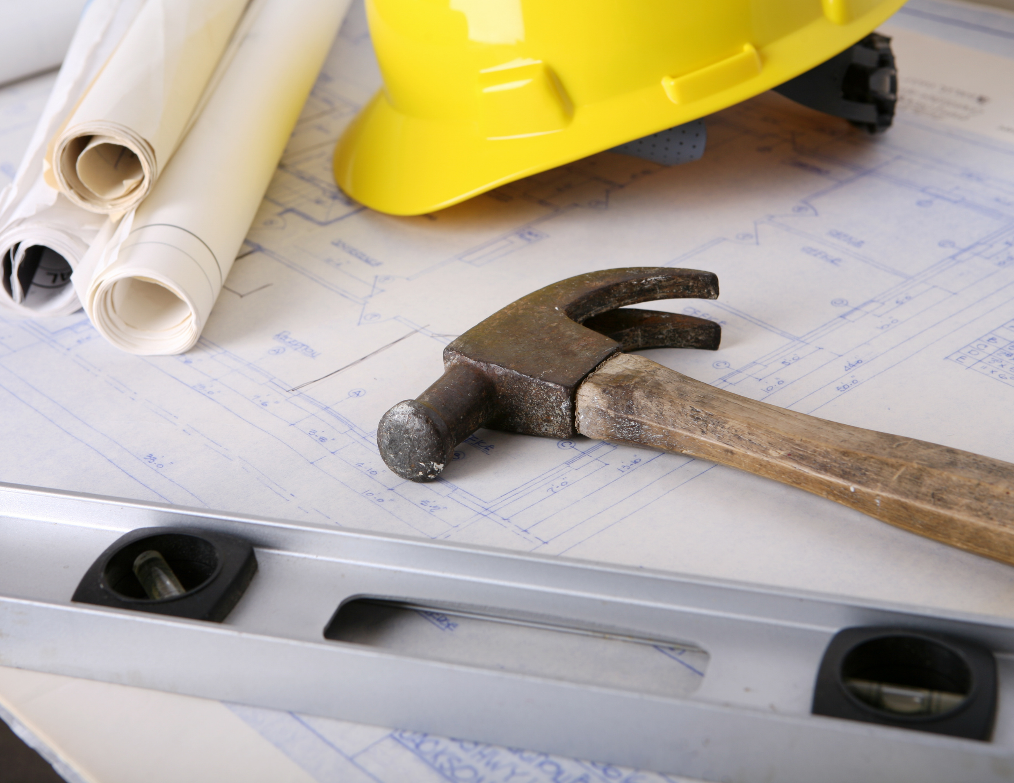 what to expect during construction shows tools, hard hat and blueprints